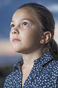 A girl looking up contemplatively, close-up Stock Photos