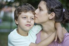 A serene mother and her affectionate son - stock photo