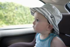 A child anticipating a car ride, sitting in car seat - stock photo