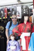 Tourist standing beside female mannequins wearing kimonos, Stock Photos