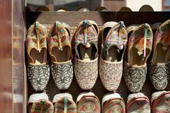 Arabian slippers for sale in the Bur Dubai Souk (market) in Dubai Stock Photos