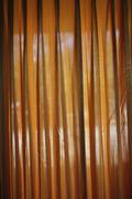 Looking through a curtain Stock Photos