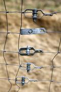 Metal fasteners holding together parts of a fence Stock Photos