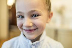 Portrait of smiling girl - stock photo