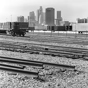 Train tracks, cargo containers and skyscrapers in Los Angeles, California, USA Stock Photos