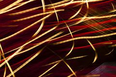 Vibrant red and gold abstract light painting Stock Photos
