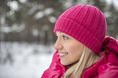 A woman wearing bright pink winter clothing outdoors Stock Photos