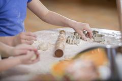 Two girls preparing dough for baking Stock Photos