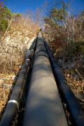 Uphill pipeline in Kufstein, Tyrol, Italy Stock Photos
