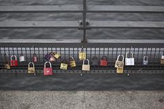 Love padlocks hanging in a row on a bridge railing in Berlin, Germany Stock Photos