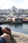 Detail of a fisherman on Galata Bridge, Istanbul, Turkey Stock Photos