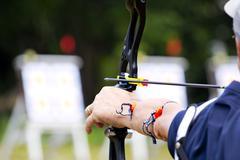 Archery holds bow aiming Stock Photos