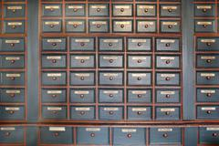 Drawers of homeopathic herbal medicines in pharmacy Stock Photos