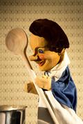 A chef puppet from the classic puppet show Punch and Judy cooking on stage Stock Photos