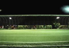 Football field at night Stock Photos