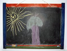 Drawing of a tree and a sun on a blackboard Stock Photos