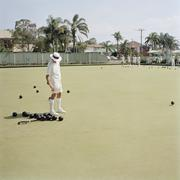 An old man hurling a bocce ball - stock photo