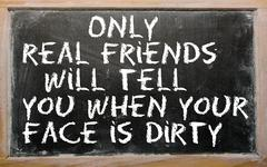 """Proverb """" only real friends will tell you when your face is dirty"""" written on Stock Photos"""