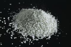 A mound of salt granules Stock Photos