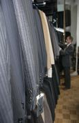 A man shopping for a suit in a clothing shop Kuvituskuvat