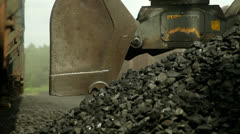 excavators, unloading coal from a cargo train. - stock footage