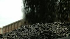 Excavators, unloading coal from a cargo train. Stock Footage