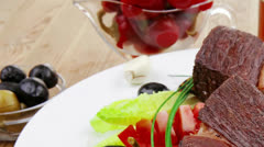 beef garnished on apples - stock footage
