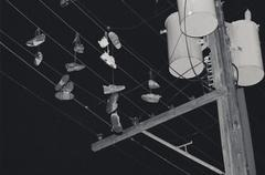 Shoes hanging from power lines Stock Photos