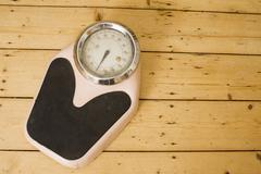 Old-fashioned bathroom scale Stock Photos