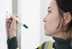 A woman writing on a whiteboard Stock Illustration