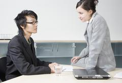 A man and woman having a business meeting in a conference room - stock photo