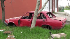 Derelict old red car carcass Stock Footage