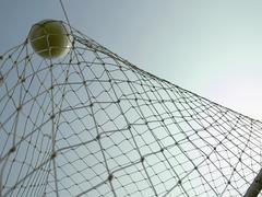 A soccer ball in a goal Stock Photos