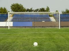 A soccer ball on the penalty marker in front of a goal Stock Photos