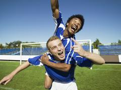 Two soccer players celebrating Stock Photos