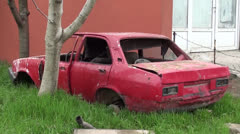 Old red car carcass Stock Footage