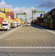 Cargo containers stacked on commercial dock Stock Photos