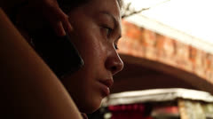 Lady listens on cell phone Stock Footage