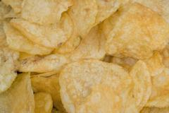 Potato chips, close-up Stock Photos