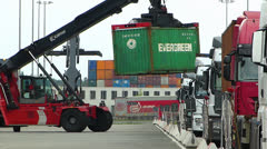 Truck lifting Evergreen container loading unloading dock harbour harbor - stock footage