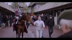 HORSE AND JOCKEY GOING TO RACE TRACK Stock Footage