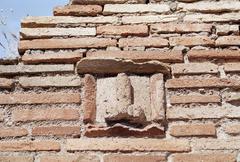 Phallus symbol carved in stone on brick wall, Pompeii, Italy - stock photo