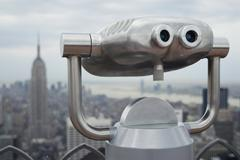 Coin operated binoculars with the Empire State Building in the background Stock Photos