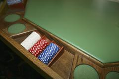 Three stacks of gambling chips at a casino table Kuvituskuvat