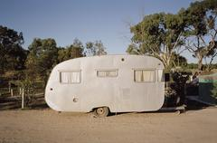Trailer parked in camping ground Stock Photos
