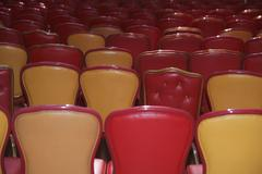 Red and beige chairs arranged in auditorium Stock Photos