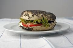 Sesame bagel with cream cheese and salad Stock Photos