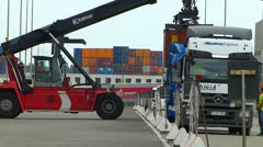SM Truck lifting container loading unloading dock harbour harbor - stock footage