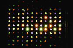 Rows of multi colored spotlights arranged in heart shape Stock Photos