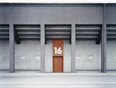 Building exterior with number above door - stock photo